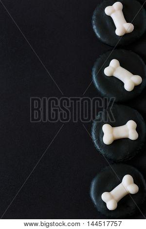Fresh halloween sugar bones and black iced cookies.