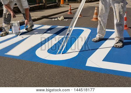 Road marking work of street workers - Close-up