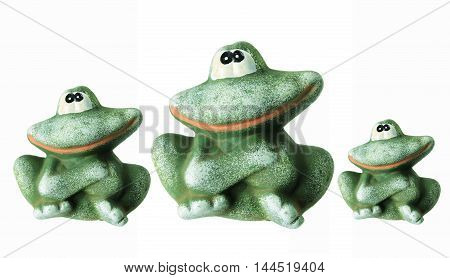 Row of Frog Figurines on White Background
