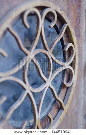 Round decorated ancient window. Architectural element. Outdoor artwork