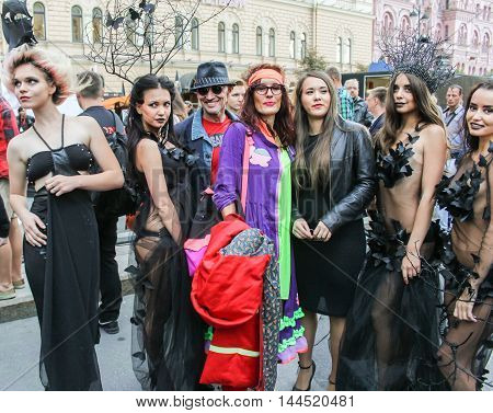 St. Petersburg, Russia - 13 August, Group posing models in designer dresses,13 August, 2016. Girls model in designer dress posing on the street.