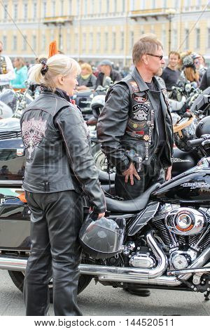 St. Petersburg, Russia - 13 August, A pair of middle-aged bikers,13 August, 2016. The annual parade of Harley Davidson in the squares and streets of St. Petersburg.