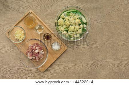Ingredient of stir fried cauliflower recipe from top view