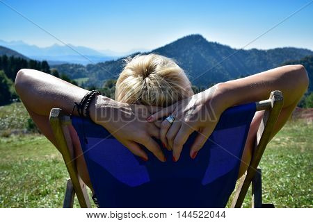 Woman relaxing on a sunbed in the Tatra mountain