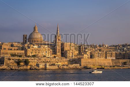 Valletta Malta - The beautiful St.Paul's Cathedral and the ancient city of Valletta at sunset with clear blue sky