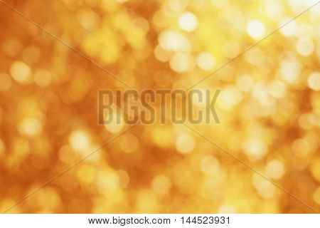 Abstract natural blur background, fantastic bokeh texture tinted in autumn colors.