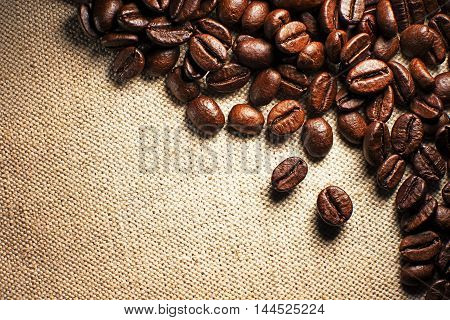 Coffee beans on the basis of goods close up.