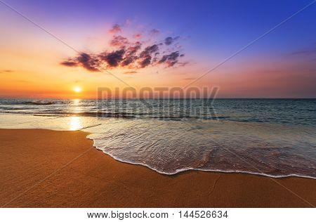 Beautiful tropical sunrise on the beach. Golden sands