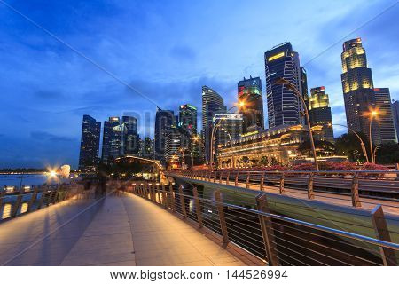 Singapore, Singapore - December 12, 2015 : Twilight view of the buildings and architectures located near the Marina Bay a famous tourist attractions in Singapore.
