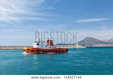 Tugboat in harbor of Montenegro, town of Bar