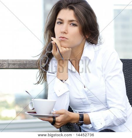 Businesswoman with a cup of cafe