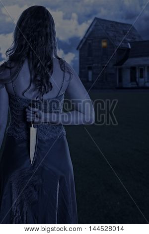 woman with knife outside house at night
