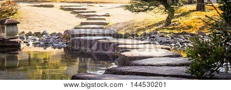 Zen Temple Japanese Stepping stone on a pond