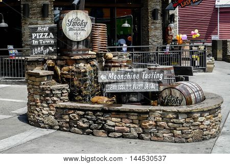 GATLINBURG-AUGUST 8:  Ole Smoky Moonshine tasting sign on street in Gatlinburg, Tennessee, USA on August 8, 2016.