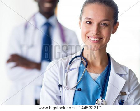 A medical team of doctors, man and woman, isolated on white background