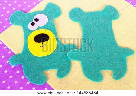 Handmade felt green bear set on violet background with polka dots. How to sew a Teddy bear toy. Felt animal patterns. Sewing lesson for children. Tutorial