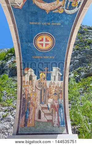 arch decorated with mosaics - the entrance to the monastery Ostrog, Montenegro.