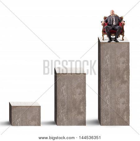 Businessman sitting in armchair on high step