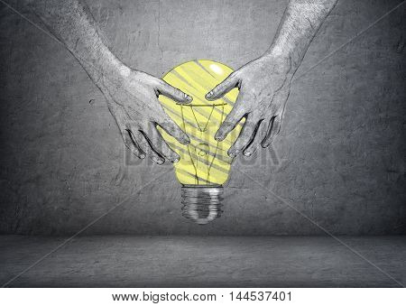 Hand drawn hands of a man holding bright yellow light bulb on a concrete background. Ideas and concepts. Thinking process. Analyzing and discovering. Imagination.