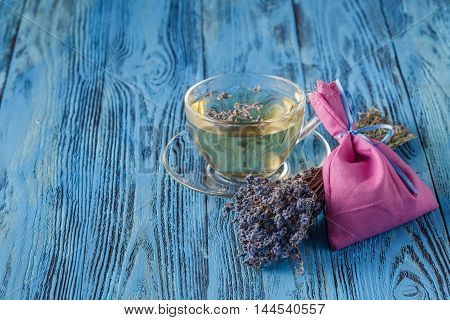 Herbal Tea with Lavender on blue wooden table