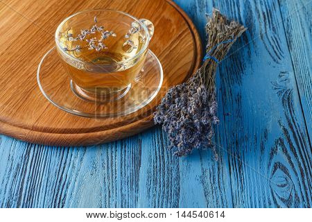 Tea with lavender flowers on wooden table