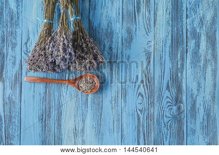Lavender on blue wooden table with spoon