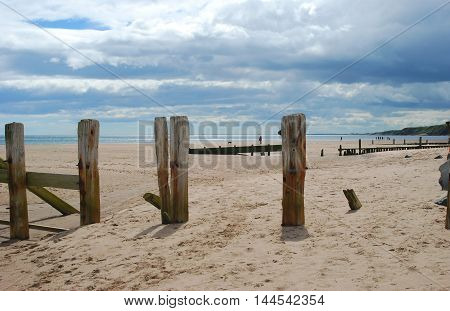 wooden weathered sea barrier on coast at Spittal