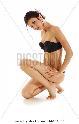 Sexy woman in erotic black lingerie isolated over white background