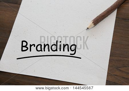 background of pencil with word branding on old wood table