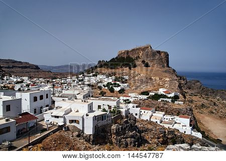 The town of Lindos and medieval fortifications at the top of the rock