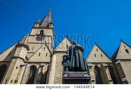 Georg Daniel Teutsch monument in front of Saint Mary Lutheran Cathedral in Sibiu city in Romania