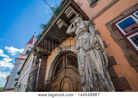 House with Caryatids statues in Sibiu city in Romania