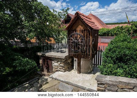 Well with wheel in Saxon Sibiel village in Romania