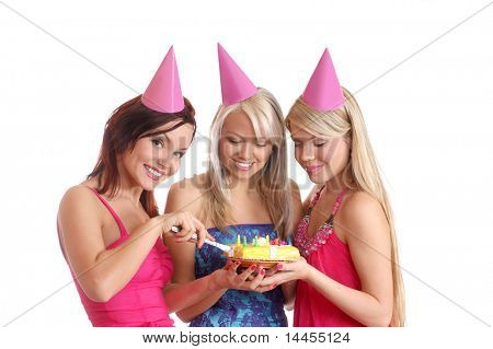 Three young attractive girls celebrate birthday party isolated over white background