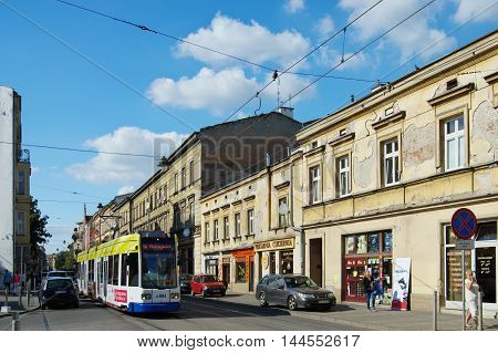 Krakow Poland - August 25 2016: Karmelicka street. Tram and monumental townhouses standing along the street.
