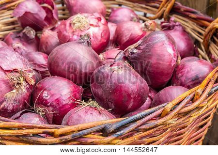 fresh tasty red onions in a basket