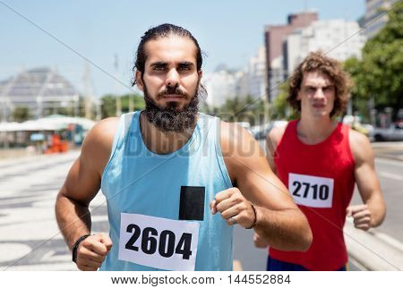Runner with beard on street with a friend