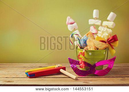 Jewish holiday purim gift with hamantaschen cookies in bucket
