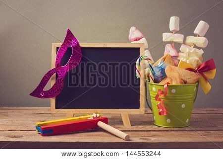 Jewish holiday purim background with chalkboard and gifts