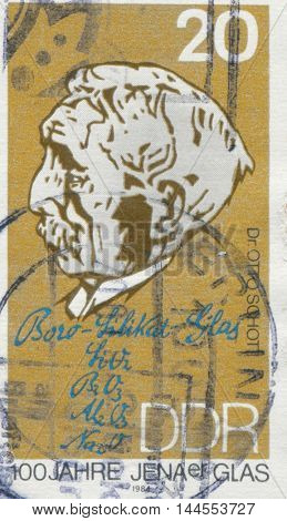 EAST GERMANY - CIRCA 1984: a stamp printed in GDR showing a portrait of Otto Schott, Chemist and Inventor of Borosilicate Glass, Jena Glass Centenary, circa 1984