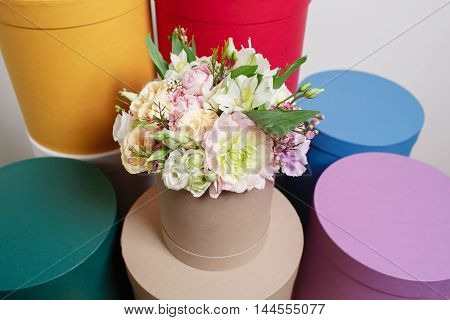 Different Colors.. Work Florist, Bouquet In A Round Box. Smelling Flowers Holding Peach Roses In Hat
