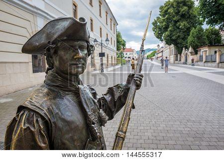 Bronze statue in front of Third Gate of the City in Citadel of Alba Iulia in Romania