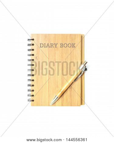 Closeup surface front of cover brown wooden diary note book with brown pen isolated on white background