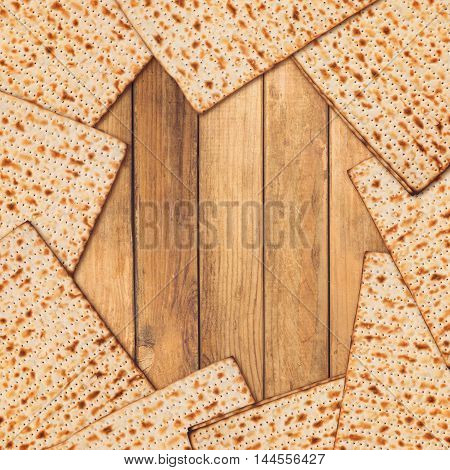 Jewish holiday Passover background. Matzo on wooden table with copy space