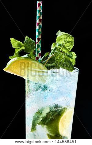 Alcohol Mojito cocktail in a glass close up black background