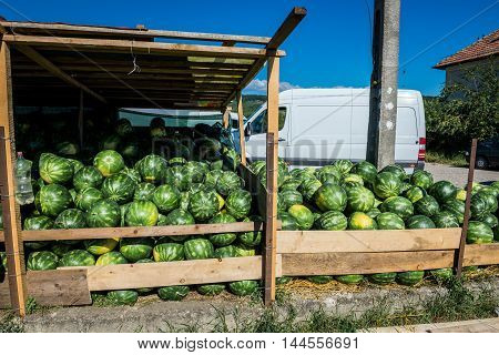 watermelons for sale on a wayside stand in Romania