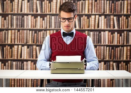 young male writer with typewriter