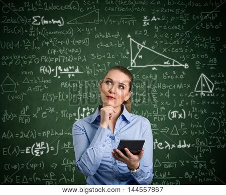 Young woman holding calculator and have problem with mathematics