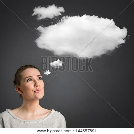 young woman looking and thinking with cloud over her head