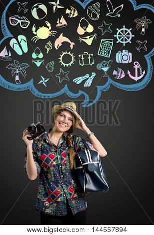 Young woman with photo camera thinking on vacation, illustrated cloud with vacation icon